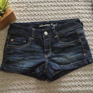 Dark wash American Eagle shorts.